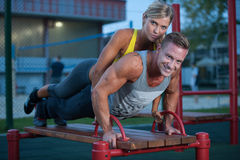 Fitness couple on a street workout royalty free stock photos