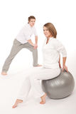Fitness - Couple stretching after training Stock Images