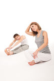 Fitness - couple stretching on white Stock Photo