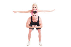 Fitness couple of trainers having ful with piggyback Stock Photos