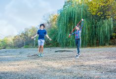 fitness couple training outdoors -Woman working out with resistance bands. stock photography