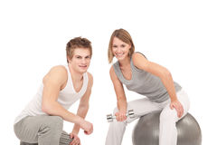 Fitness - Couple training with weights Stock Images
