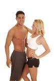 Fitness couple white sports bra man no shirt Stock Images