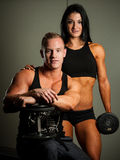 Fitness couple working out in fitness royalty free stock images