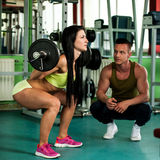 A Fitness couple workout - fit mann and woman train in gym Stock Photos