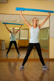Fitness dance class aerobics. Women dancing happy energetic in g. Ym fitness class Stock Images