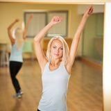Fitness dance class aerobics. Women dancing happy energetic in g. Ym fitness class Stock Image