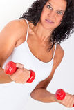 Fitness. Detail -  fitness instructor holding small weights Stock Images