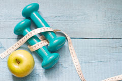 Fitness and diet abstract concept with dumbbells Royalty Free Stock Photography