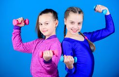 Fitness diet for energy health. triceps workout of small girls hold dumbbell. Sport success. weight lifting for muscules royalty free stock photo
