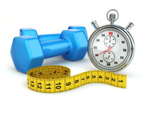 Fitness and dietimg concept. Stopwatch and dumbbells. Stock Photos