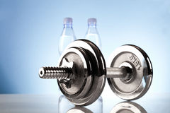 Fitness dumbbell with mineral water Stock Photos