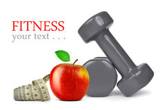 Fitness dumbbells with apple Stock Photo