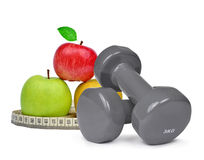 Fitness dumbbells with apples Royalty Free Stock Photography
