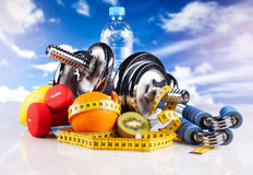 Fitness dumbbells with  fruits Royalty Free Stock Photography