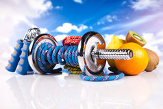 Fitness dumbbells with  fruits Stock Photo
