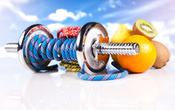 Fitness dumbbells with  fruits Royalty Free Stock Photos