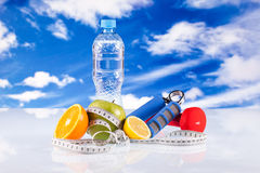 Fitness dumbbells and fruits Stock Photography