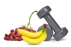 Fitness dumbbells with grapes and banana Royalty Free Stock Images
