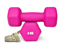 Fitness dumbbells with measuring tape Royalty Free Stock Photos