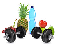 Fitness dumbbells, PET bottle with drinking water and fruits Royalty Free Stock Photography
