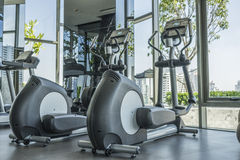 Fitness. Elliptical cross trainer in  fitness room Stock Images