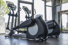 Fitness. Elliptical cross trainer in  fitness room Stock Photos