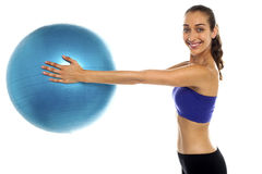 Fitness enthusiast holding a swiss ball Stock Photos