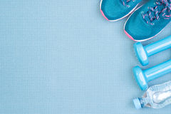 Fitness equipment on blue background Royalty Free Stock Photo