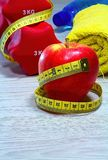 Red apple with measure tape on board royalty free stock photo