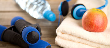Fitness equipment - dumbbells and towel Royalty Free Stock Image