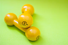 Set of dumbbells on yoga mat Stock Photos