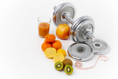 Fitness equipment and healthy food, apple, nectarines, kiwi, lem Royalty Free Stock Images