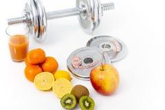 Fitness equipment and healthy food, apple, nectarines, kiwi, lem Stock Photo