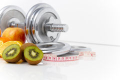 Fitness equipment and healthy food, apple, nectarines, kiwi, lem Stock Images