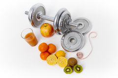 Fitness equipment and healthy food, apple, nectarines, kiwi, lem Stock Image
