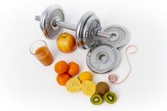 Fitness equipment and healthy food, apple, nectarines, kiwi, lem Stock Image