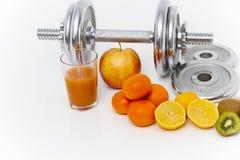 Fitness equipment and healthy food, apple, nectarines, kiwi, lem Stock Photography