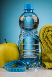 Fitness equipment and healthy food. Composition Royalty Free Stock Photo