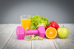 Fitness equipment and healthy food. Stock Photos