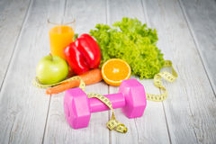 Fitness equipment and healthy food. Stock Image