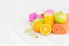 Fitness equipment and healthy food. Stock Photography