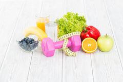 Fitness equipment and healthy food. Royalty Free Stock Photo