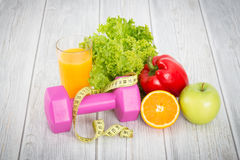 Fitness equipment and healthy food. stock images