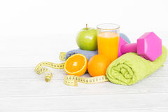 Fitness equipment and healthy food. Royalty Free Stock Images