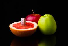 Fitness equipment. Healthy food. grapefruit , water, apple, fresh, clear, fruits. Fitness equipment. Healthy food. grapefruit , water, apple fresh clear fruits Stock Image