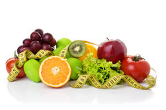 Fitness equipment and healthy food. Isolated on white. apple, pepper, grapes, kiwi, orange, dumbbells and measuring tape Royalty Free Stock Photography
