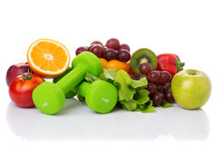 Fitness equipment and healthy food. Isolated on white. green apple, pepper, grapes, nectarines, kiwi, orange, dumbbells and measuring tape Stock Images