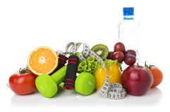 Fitness equipment and healthy food. Isolated on white. green apple, pepper, grapes, nectarines, kiwi, orange, dumbbells and measuring tape Stock Photo