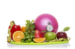 Fitness equipment and healthy food isolated on white Stock Photography